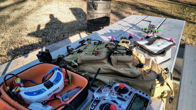 Quadcopter Flying Gear Spread Out On A Picnic Table